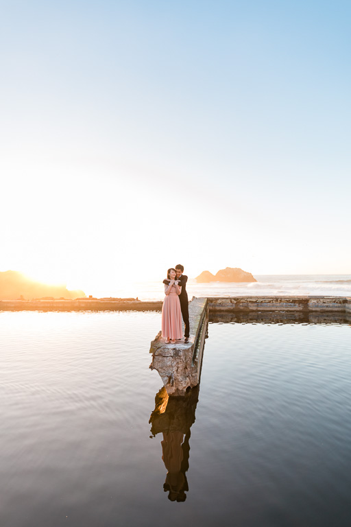 golden sunset engagement picture at Sutro Baths