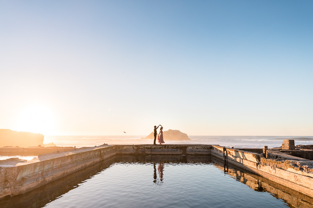 Photo of couple twirling on the Sutro Baths ruins