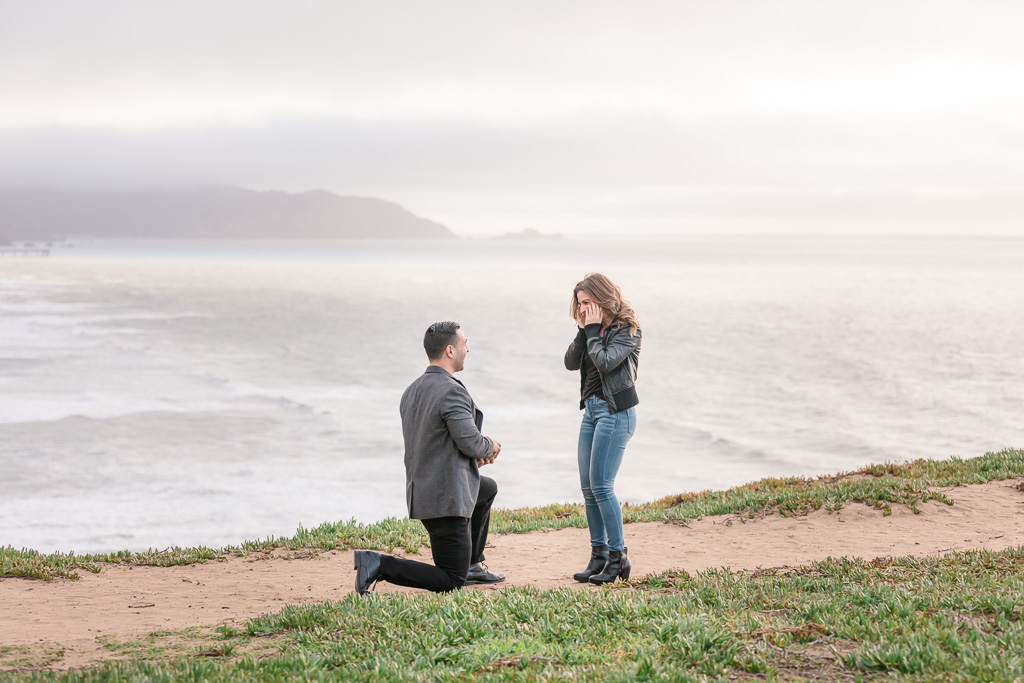 San Francisco romantic surprise proposal by the ocean at Mussel Rock Park
