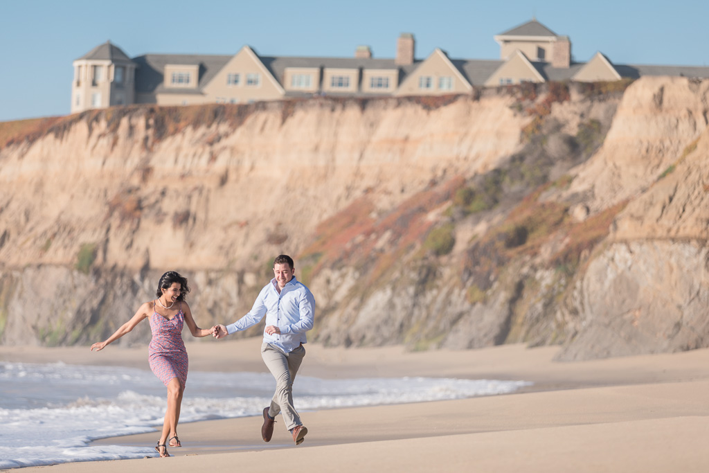 fun engagement photo in Half Moon Bay by the pacific ocean