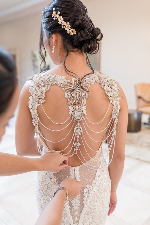 zipping up this delicate back of a designer gown
