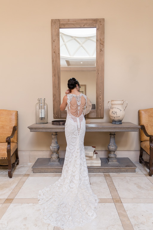 bride in her galia lahav wedding gown with a stunning back design