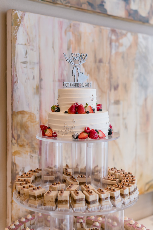 wedding dessert display with a cake at the top