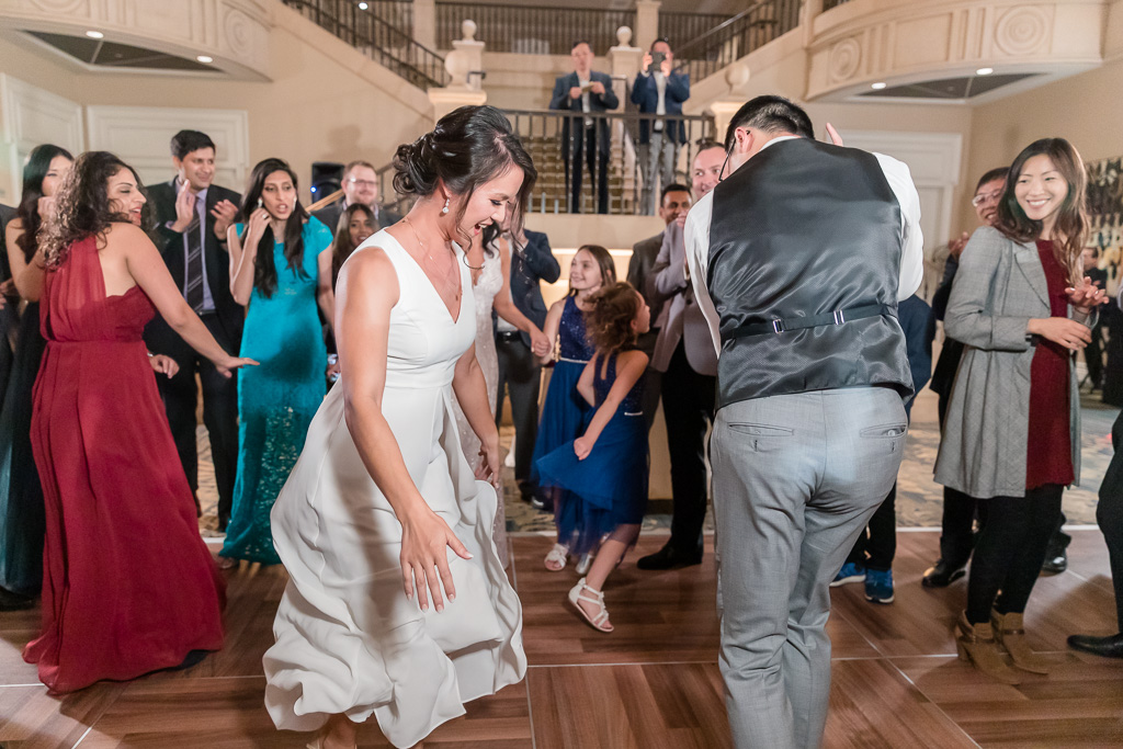 newlyweds dancing together