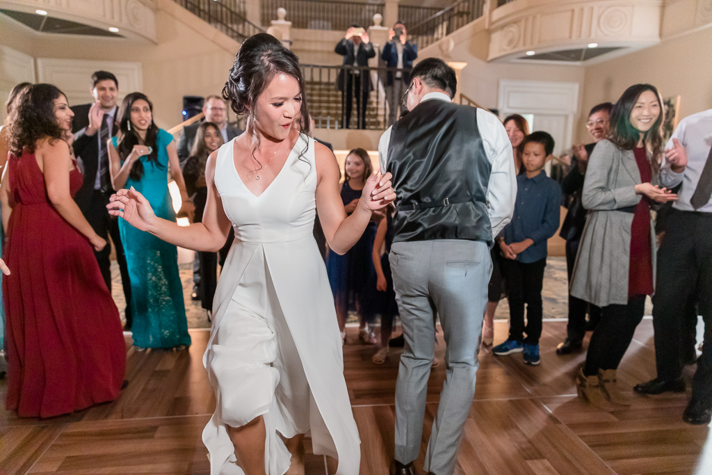 bride and groom being funky during their dance party