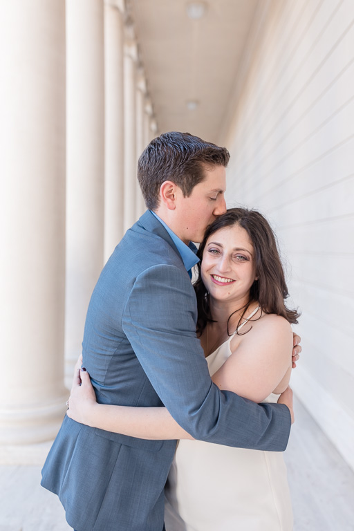 couple cuddling for their engagement session