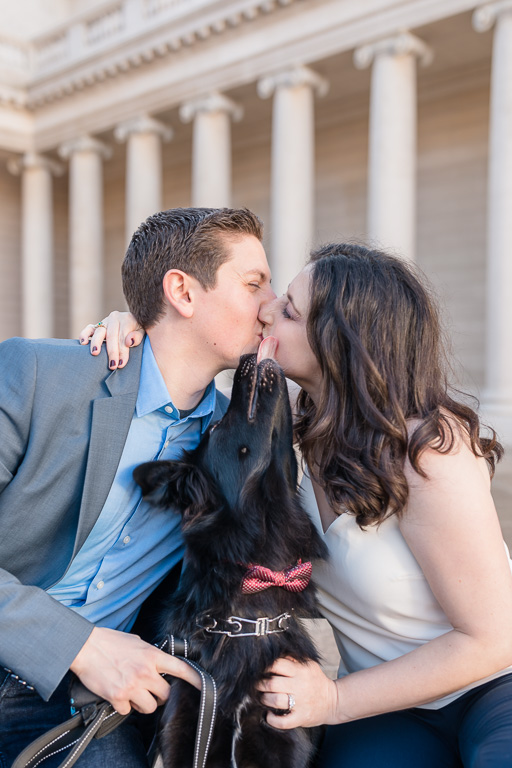 puppy wants to join in the kissing at parents' San Francisco engagement session