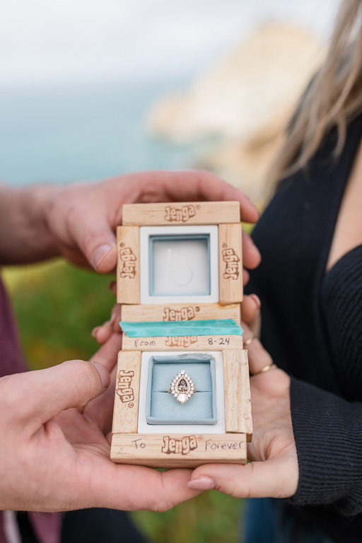 a designer engagement ring in a custom made jenga ring box