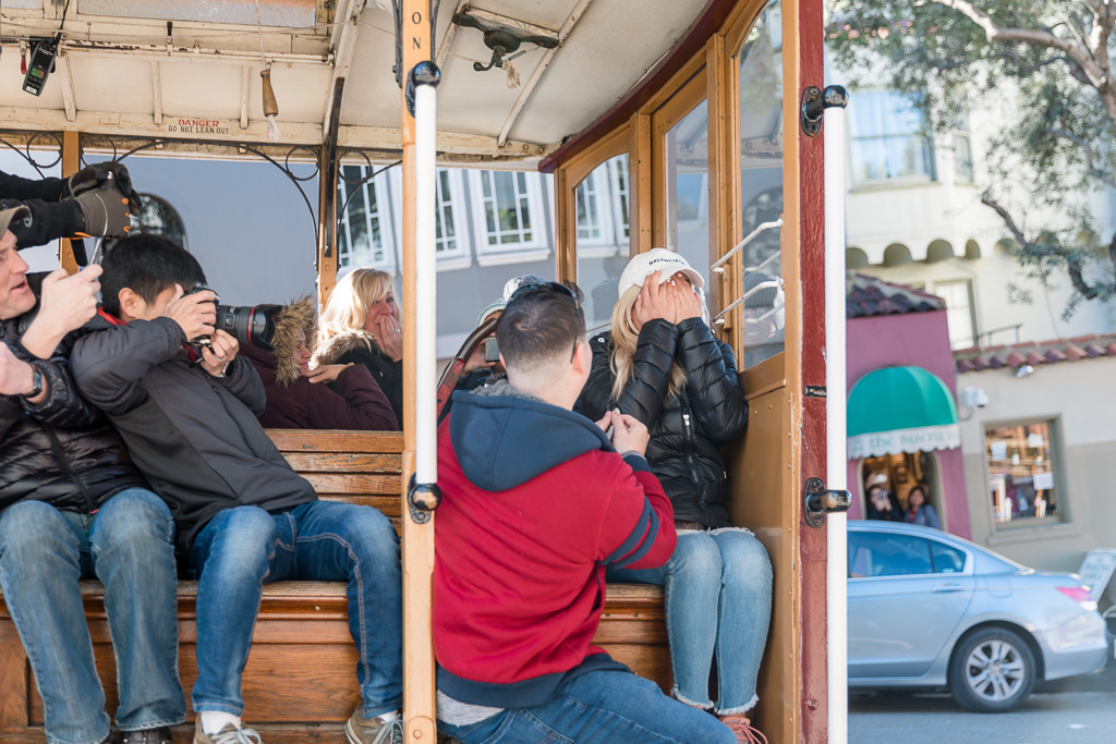 proposal inside the cable car while driving down the San Francisco hill
