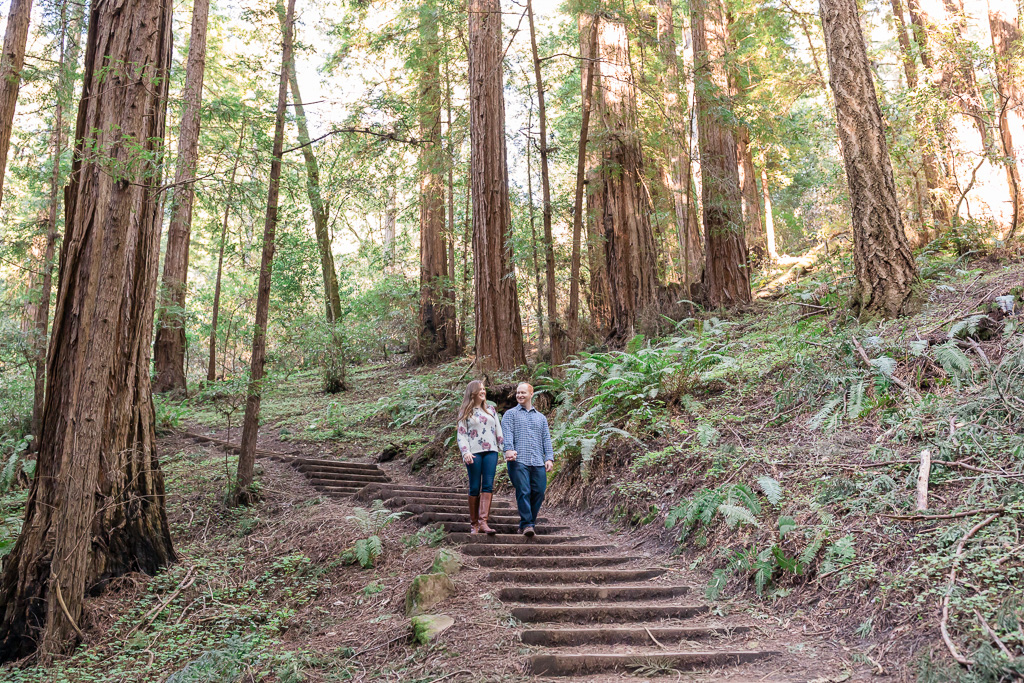 engagement photo at Muir Woods surrounded by redwood trees
