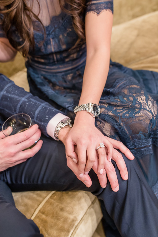 close up of holding hands and showing ring and watch
