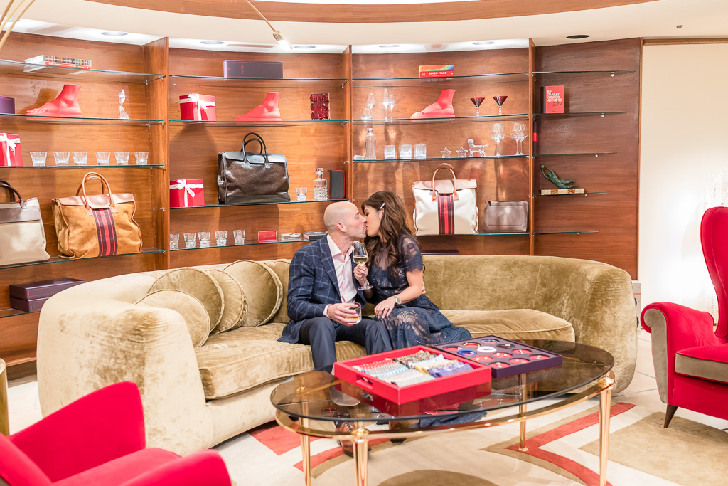 kissing on a sofa at Italian high end designer fashion store