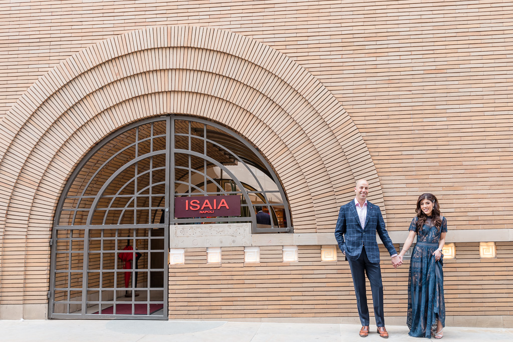 engagement photos at Maiden Lane ISAIA store next to spiral entrance