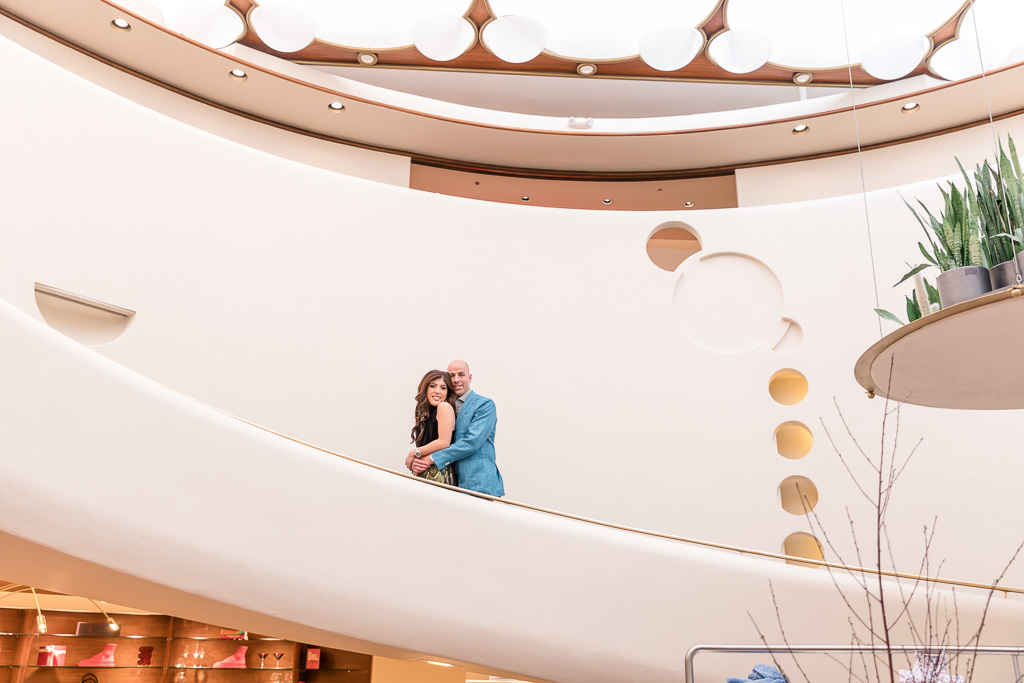 white spiral staircase posed engagement shoot