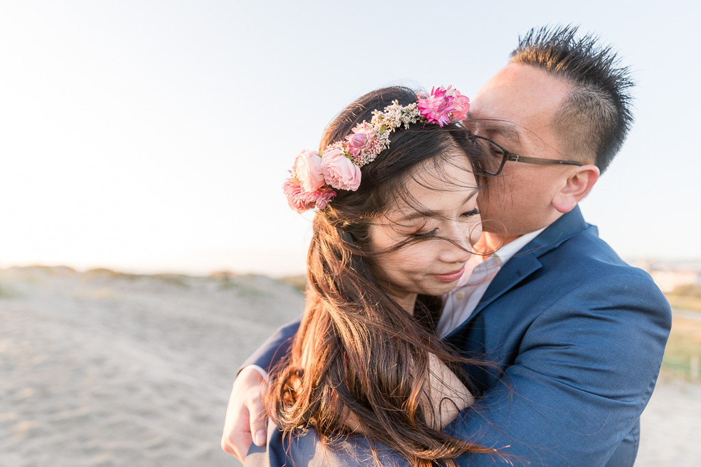 romantic San Francisco sunset engagement photo on the beach with a flower crown