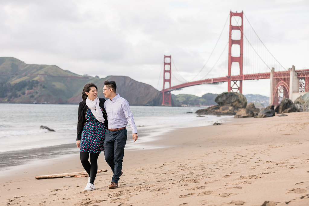 couple walking on the in San Francisco soft sand beach