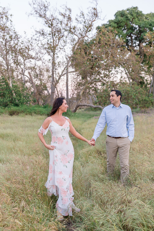 walking in the nature holding hands save the date photo