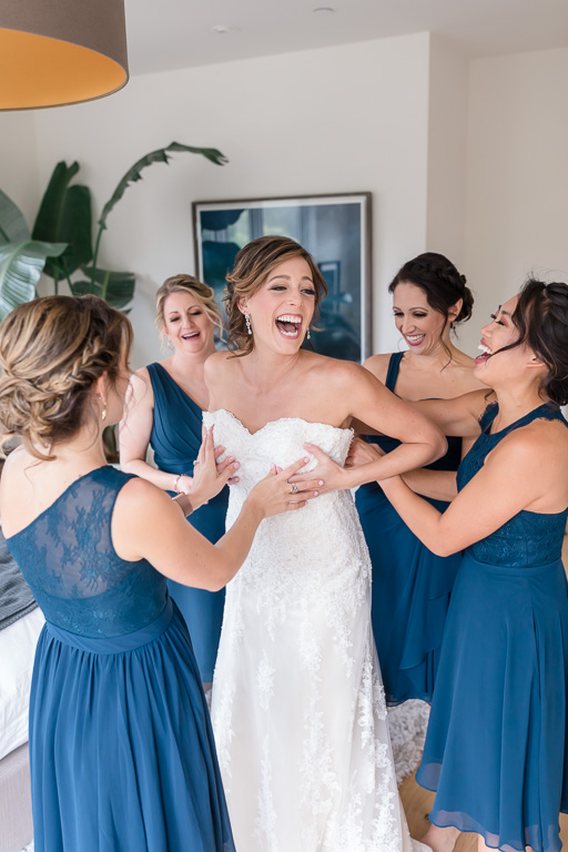 San Francisco bride laughing hard in her wedding gown during getting ready
