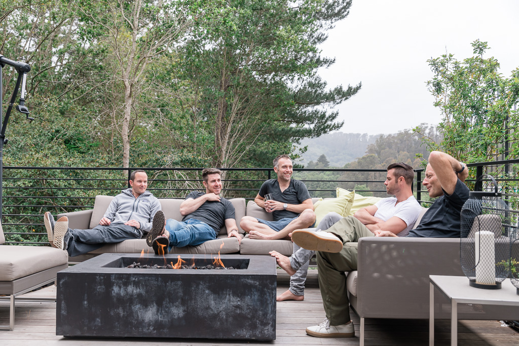 guys chilling by the patio fireplace