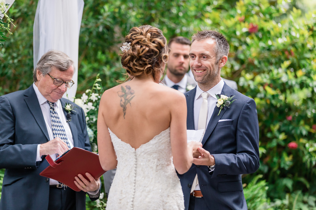 bride reading her vows and the look on groom's face is adorable