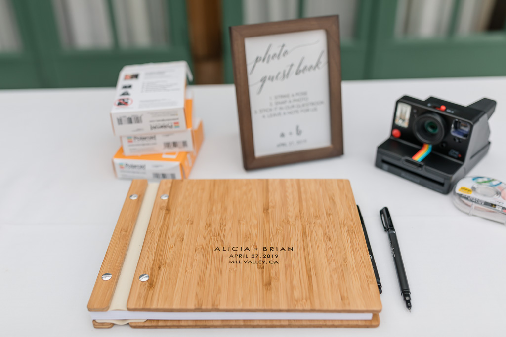 guest sign-in table with Polaroid camera