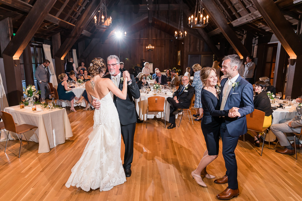 bride and groom dancing with their parents at the same time