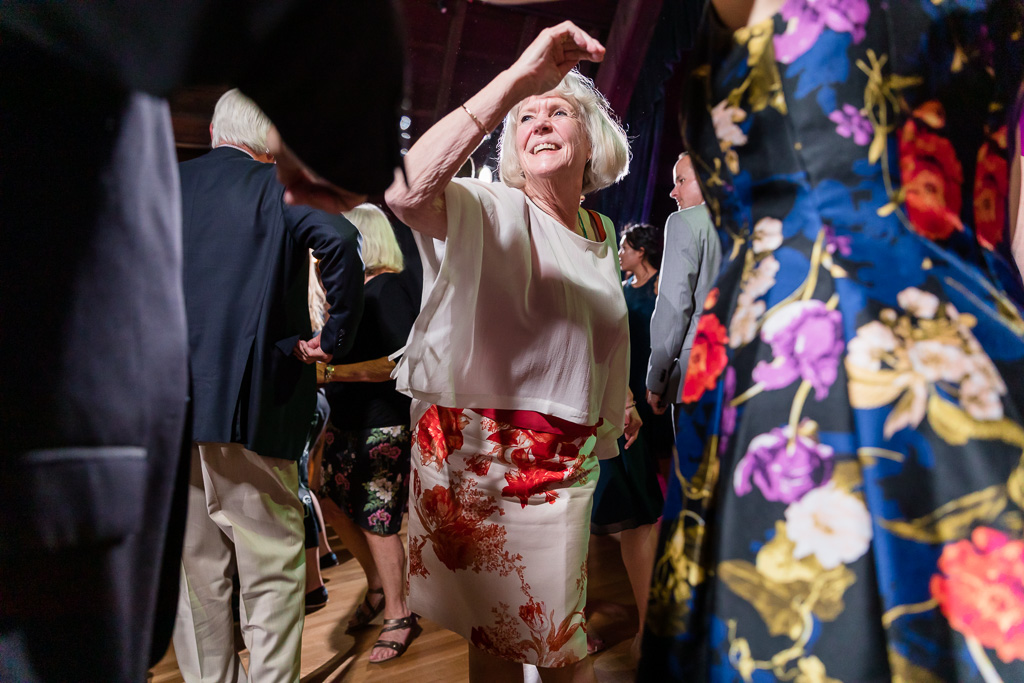 an older wedding guest having so much fun on the dance floor