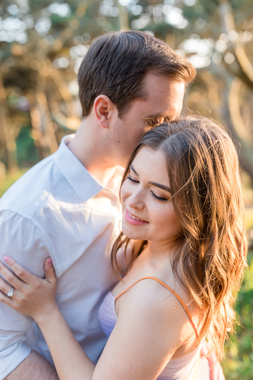 beautiful bay area outdoor woodsy engagement photo under golden light