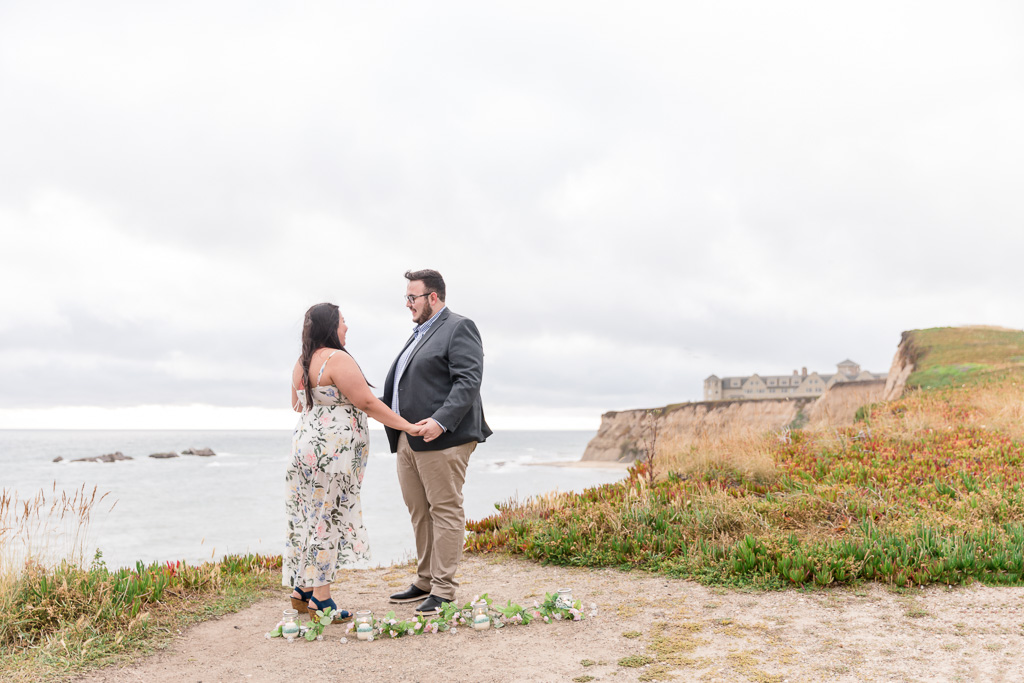 cute surprise proposal in Half Moon Bay on a secluded cliff