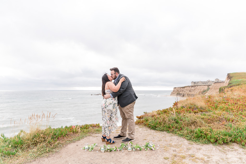 first kiss after they got engaged here at Half Moon Bay Ritz Carlton