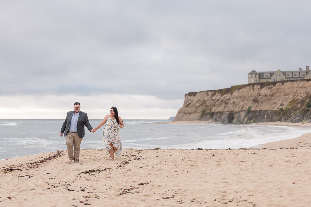 they got engaged here on the cliff above this sand beach