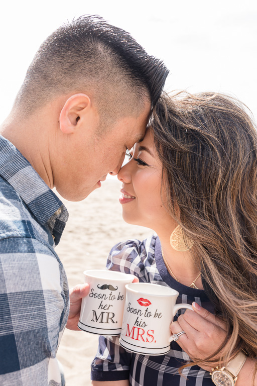 cute portrait of San Francisco couple holding their engagement mug