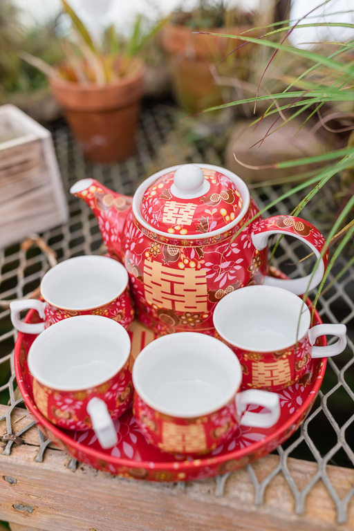 red teapot and cups for tea pouring ceremony - San Francisco Asian wedding