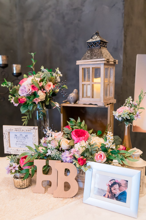 wedding welcome table high-end floral and lantern design