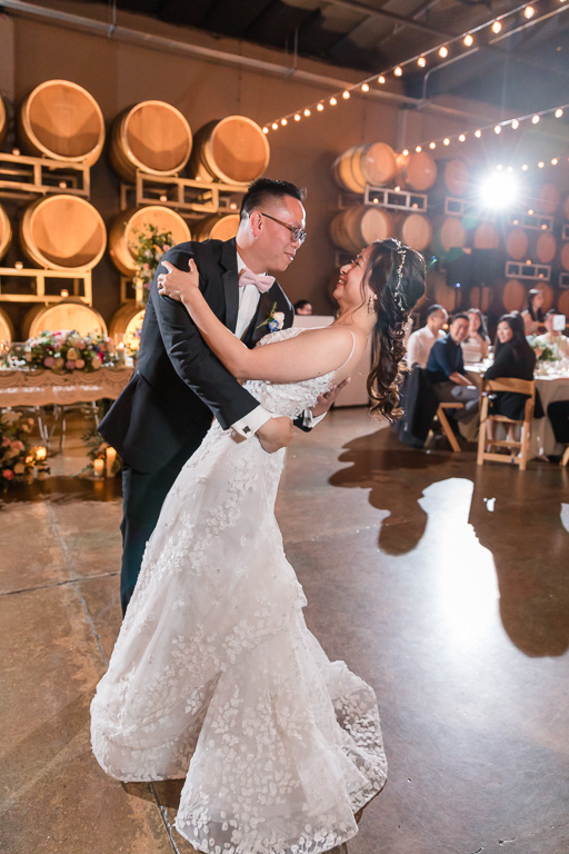 a romantic dip during the first dance at Domenico Winery