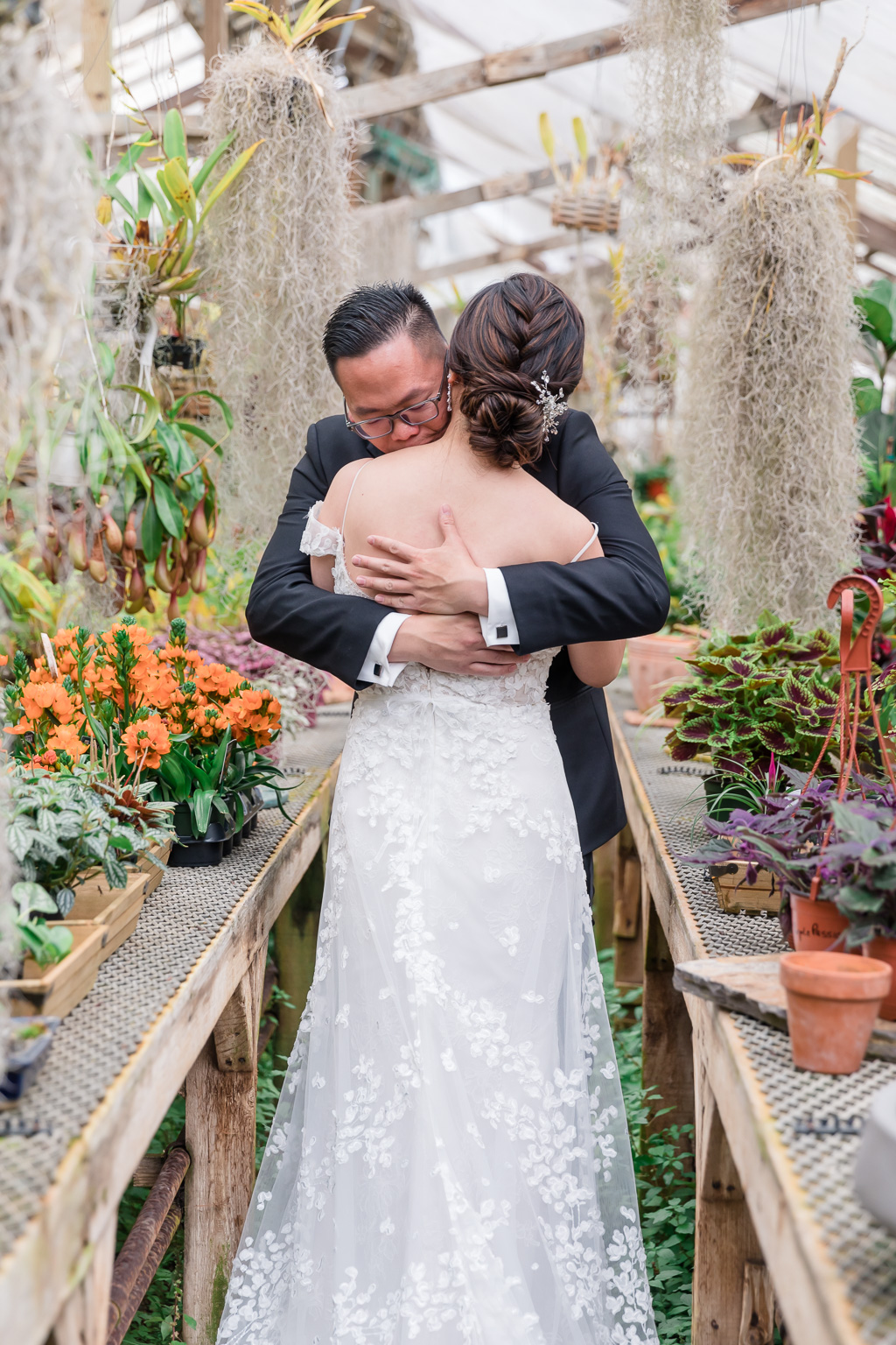 a touching wedding first look at Shelldance Orchid Gardens