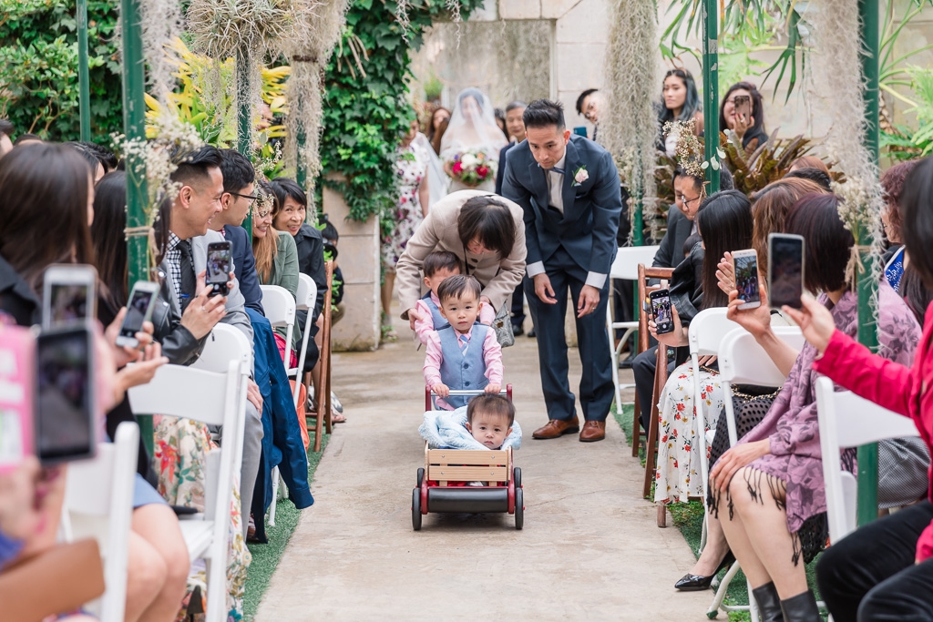 tiny ring bearer in his wagon