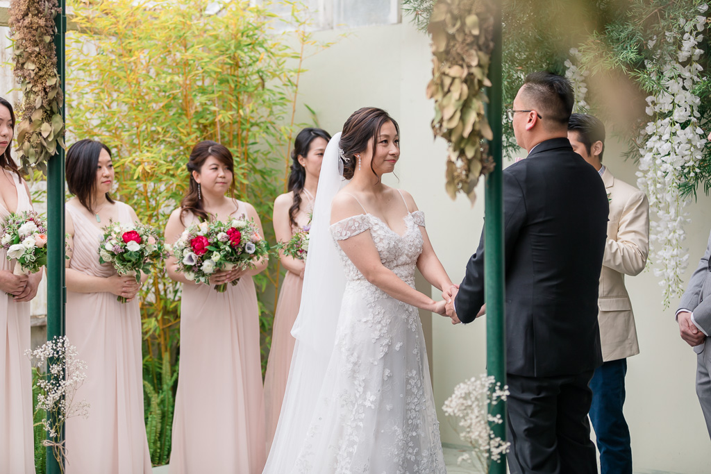 bride and groom joining hands