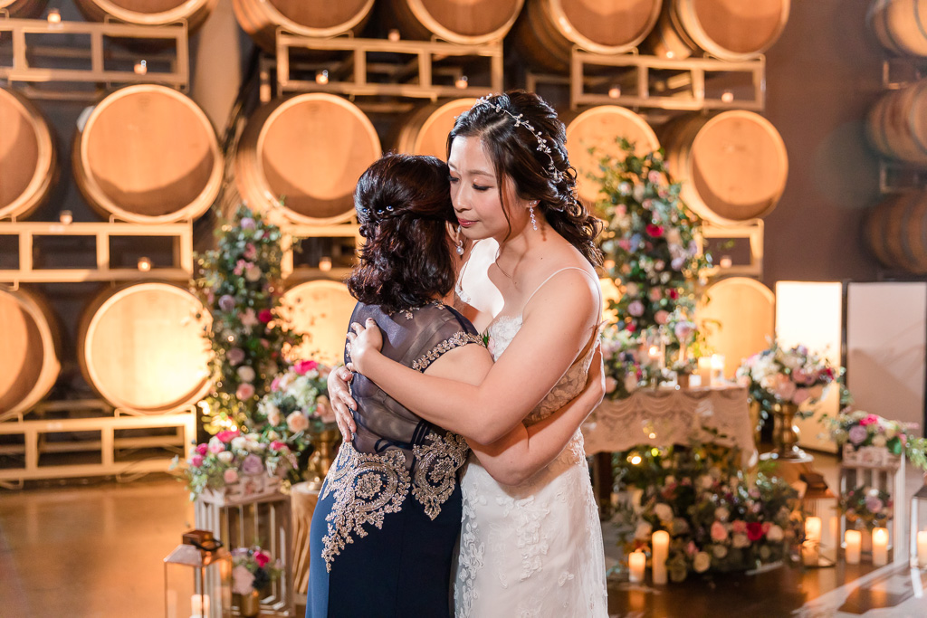 bride slow dancing with her mother
