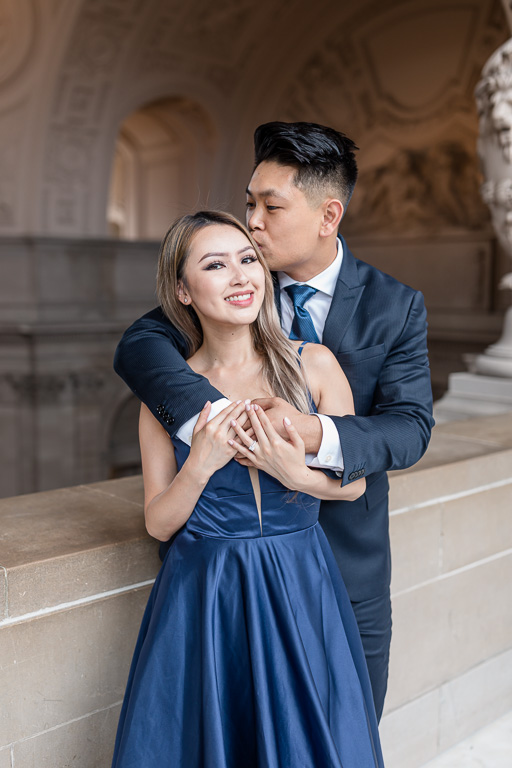 happy engaged couple at City Hall 4th floor