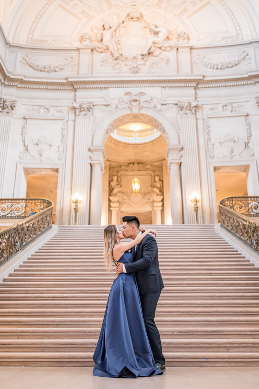 pretty SF engagement photo in a grand architectural setting