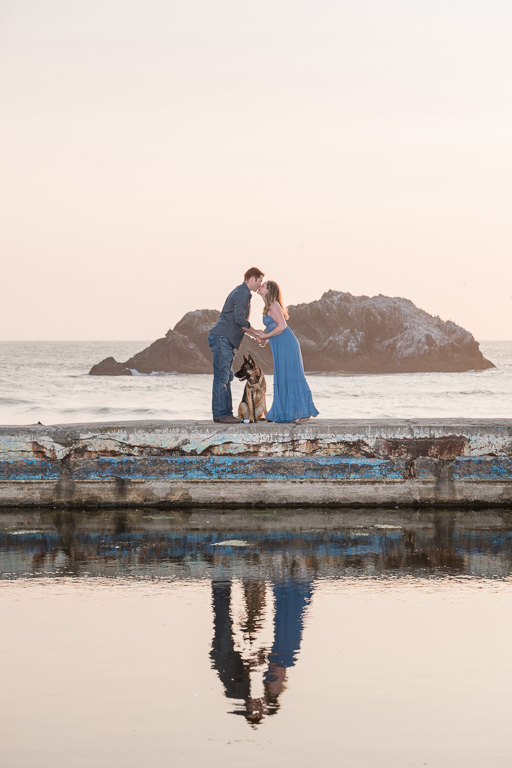 kissing engagement photo with dog in San Francisco by the water