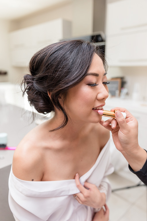bride having her makeup done under beautiful natural light