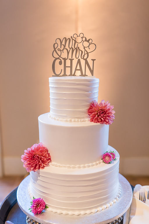 wedding cake with a cute topper