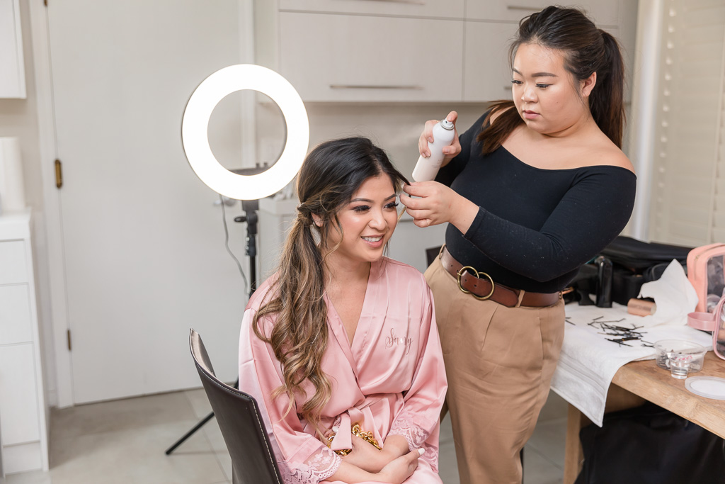 bridesmaid getting her hair fixed by the stylist