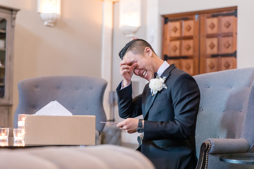 groom got emotional when reading the card from the bride