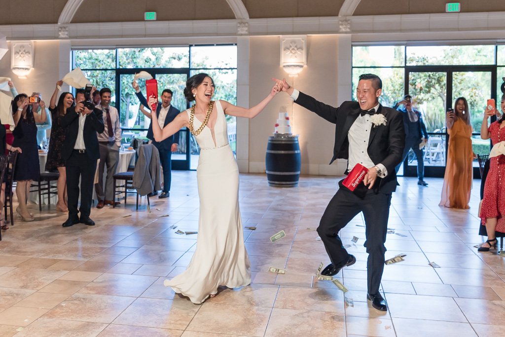 bride and groom's grand hipster entrance at the reception
