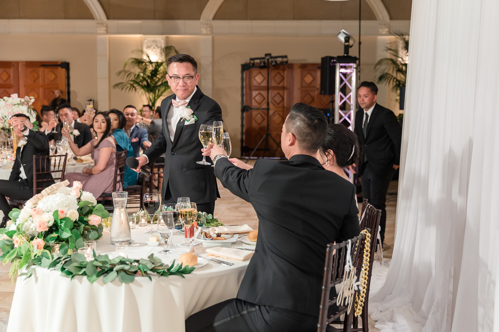 father of the groom toasting the couple