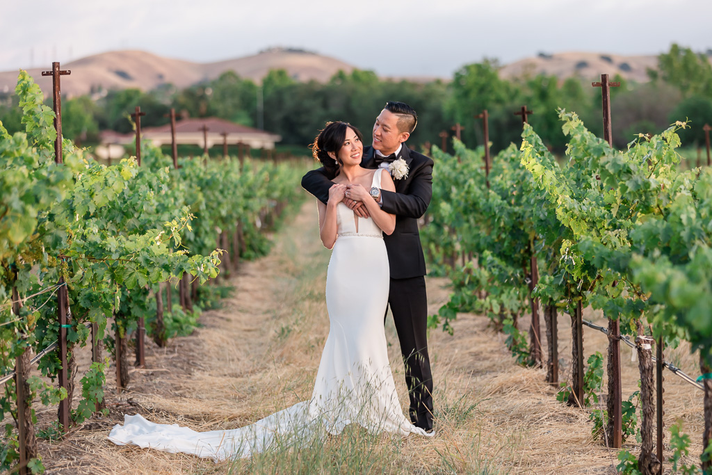 Casa Real at Ruby Hill Winery wedding bride and groom sunset portrait in the vineyards