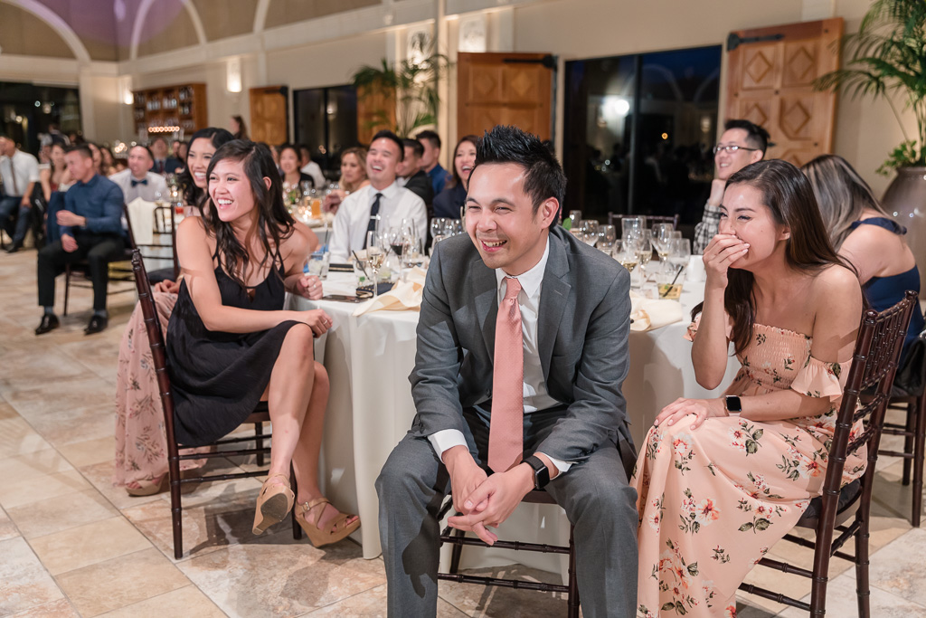 wedding guests laughing at the toast